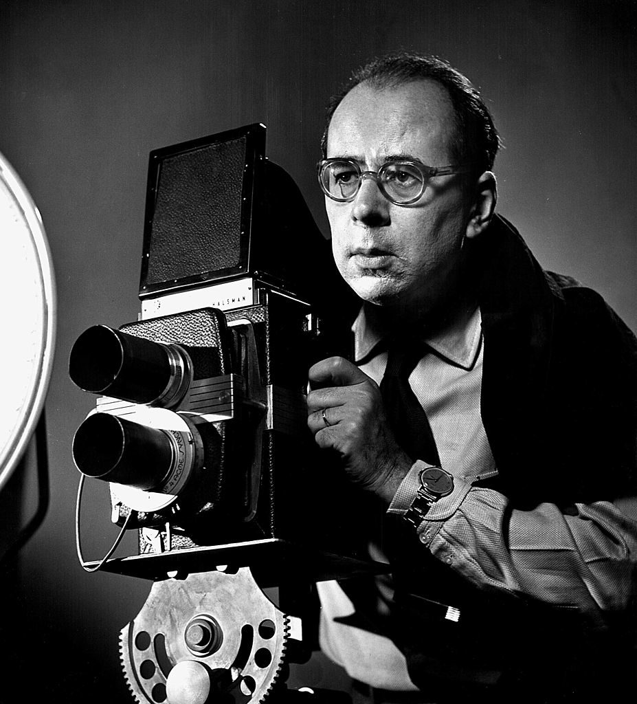 LIFE photographer Philippe Halsman poised w. camera in serious portrait. (Photo by Yale Joel/The LIFE Picture Collection © Meredith Corporation)