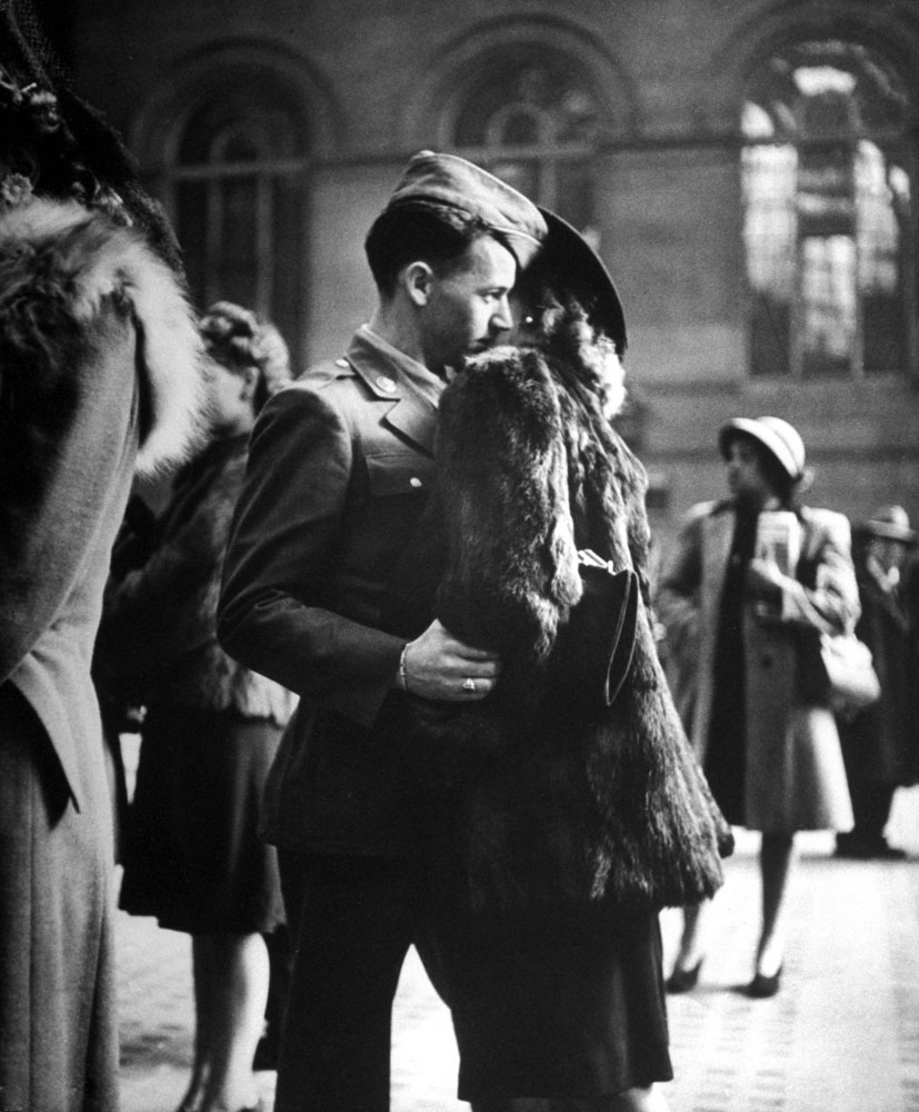A soldier saying farewell at Penn Station in December 1943.