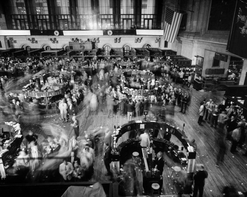 Men leave the floor of the New York Stock Exchange during an air raid drill in November 1951.