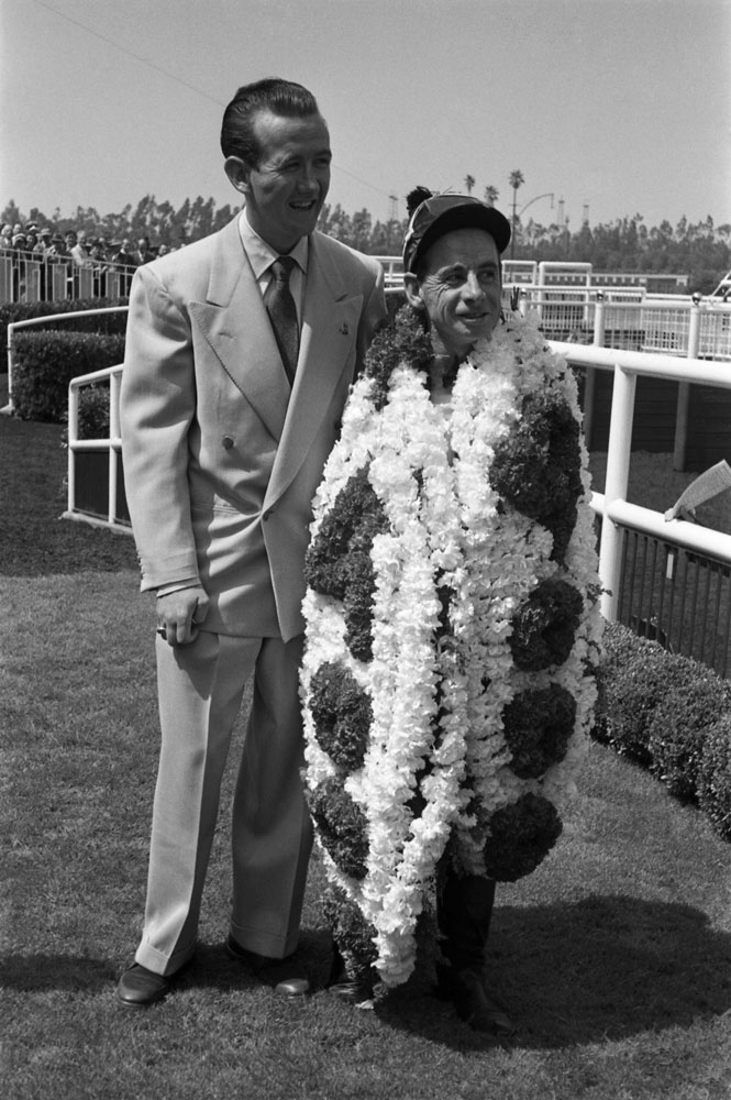 Johnny Longden poses after his 4,000th career win in 1952.