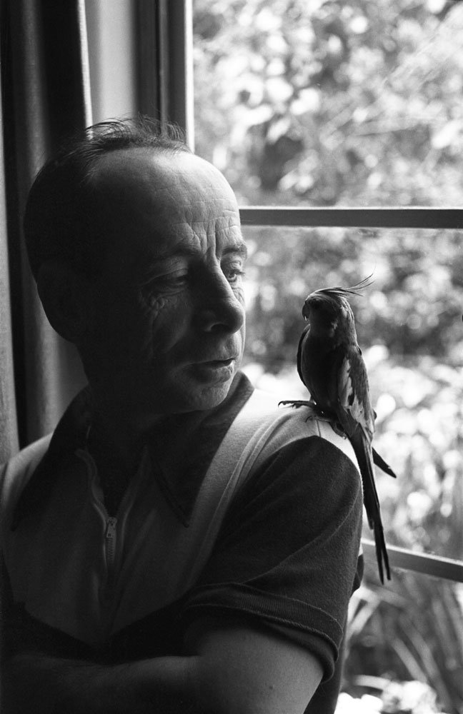 Jockey Johnny Longden with his pet cockateil, 1952.