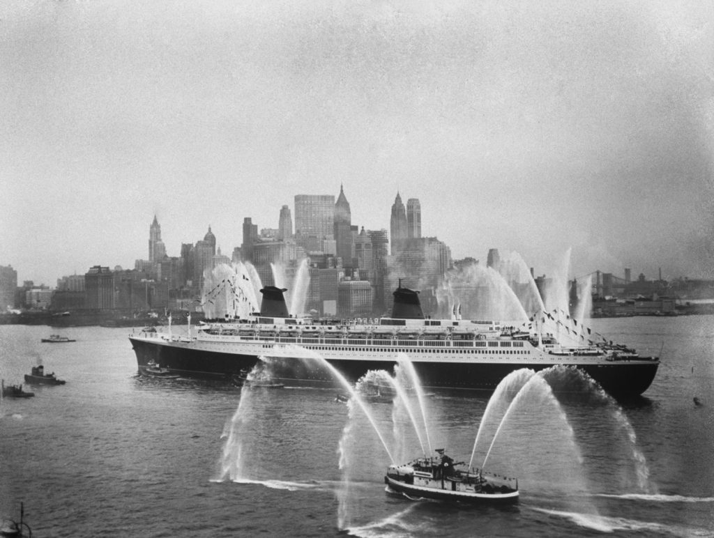 Fire boats greet the SS France as it enters New York Harbor on its maiden voyage in February 1962.