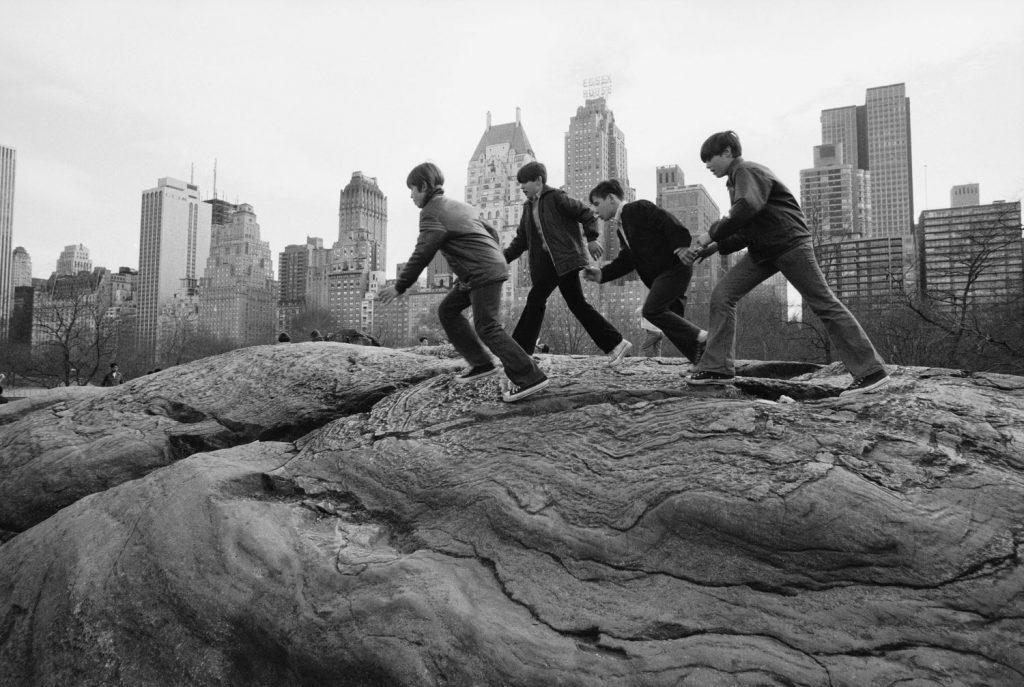 Boys climb on rocks in Central Park, November 1972.