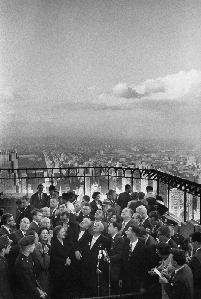 Nikita S. Khrushchev and his wife, center, meet the press at the top of the Empire State building in September 1959.