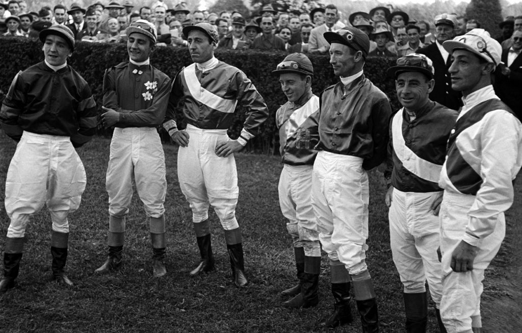 Johnny Longden (second from right) with fellow jockeys, Laurel Park, Maryland, 1952.