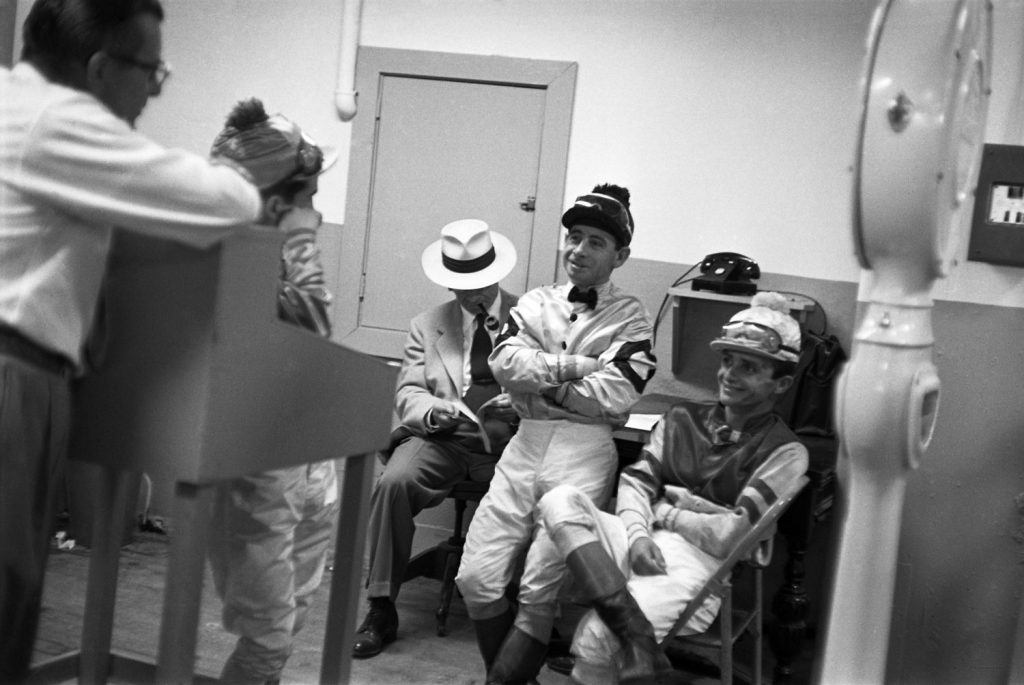Johnny Longden (second from right) with fellow jockeys, Hollywood Park, 1952.