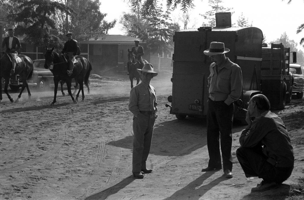 Johnny Longden (hands in pockets) in 1952.