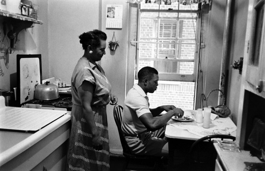Willie Mays at home in Harlem with his landlady, Mrs. Ann Goosby.