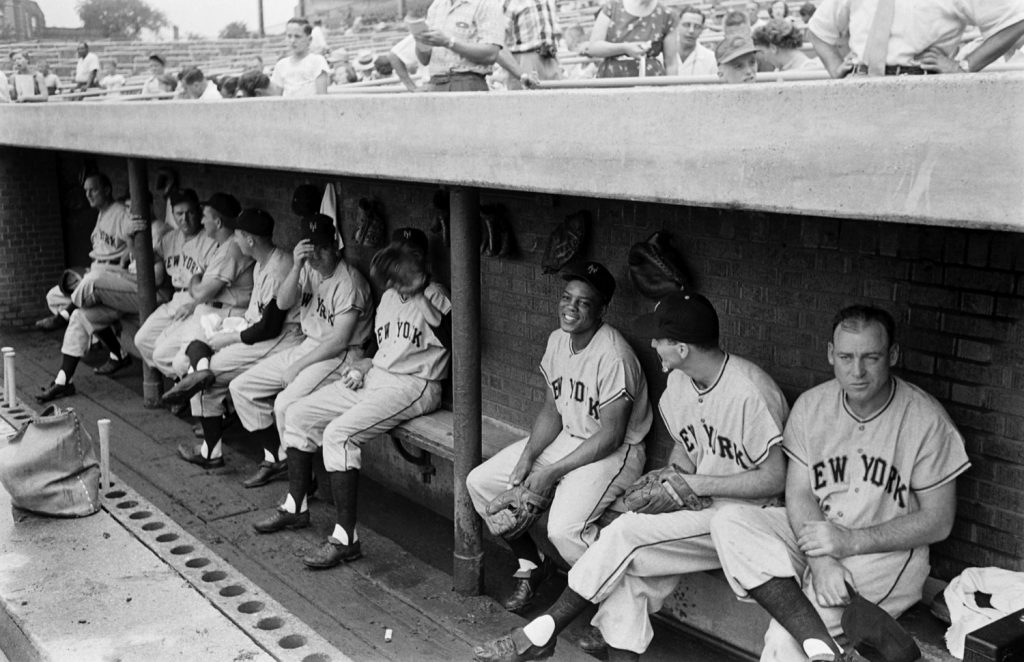 Willie Mays and teammates in the dugout, spring training, 1954.
