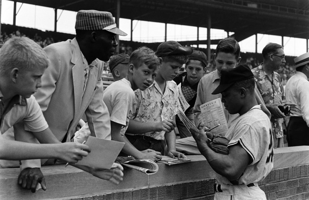 Willie Mays signs autographs for fans, 1954.