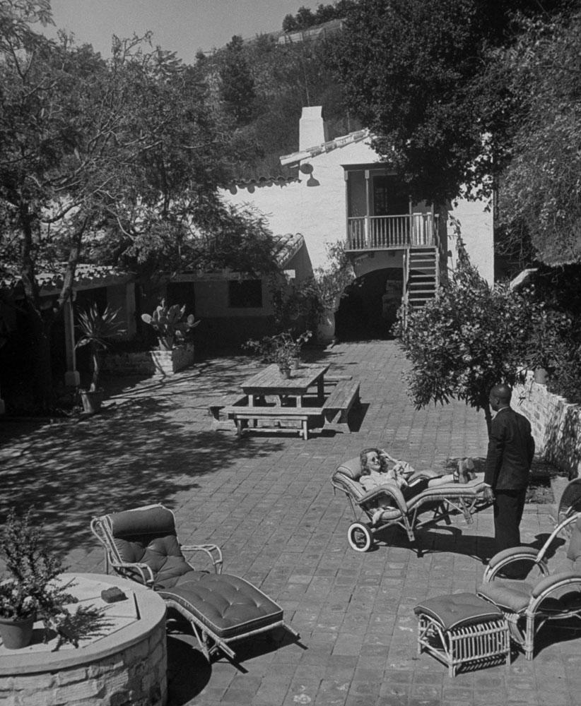 Bette Davis' Chauffeur Wheels Her Around in the Backyard in Beverly Hills in 1939.