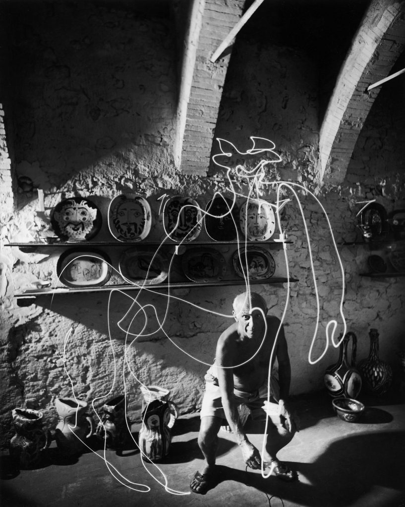 "Pablo Picasso ""draws"" a centaur in the air with light, 1949."