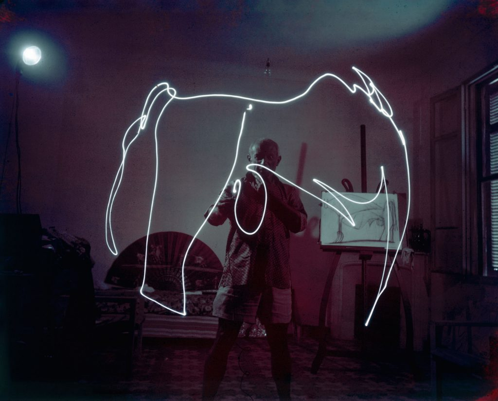 Pablo Picasso creates a light drawing, 1949.