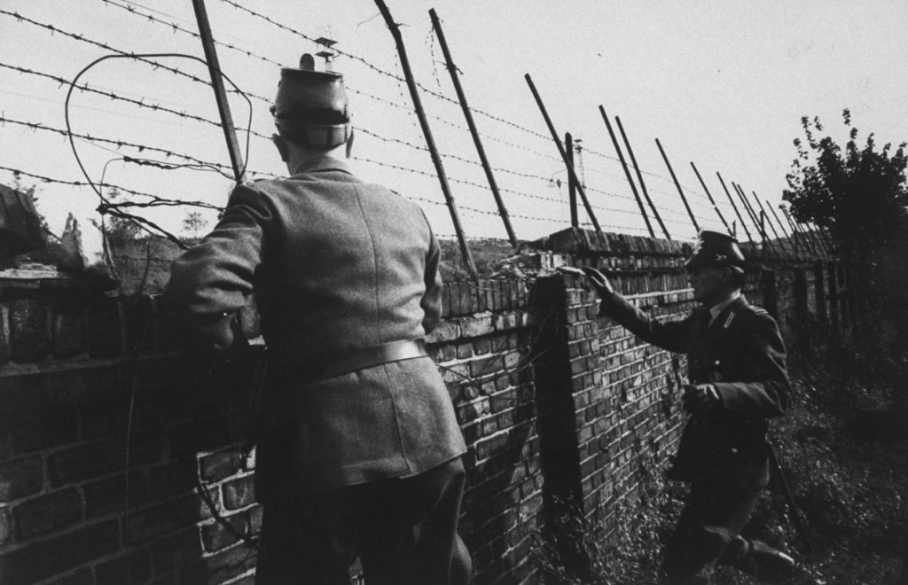 West German police look out over the Berlin Wall for potential escapees to the West