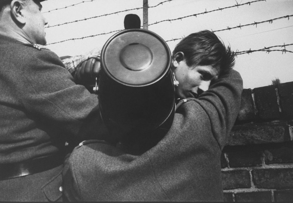 An East German teen escapes over the Berlin Wall to the West