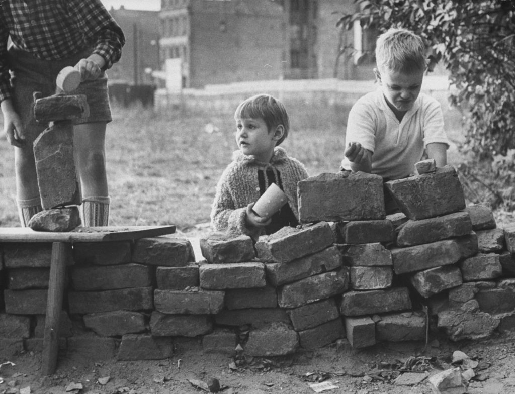 West Berlin children build a pretend Berlin Wall