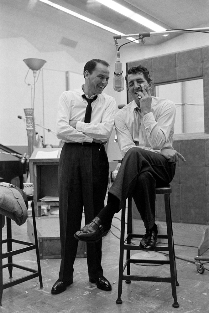 Frank Sinatra and Dean Martinshare a light moment in the recording studio in 1958.