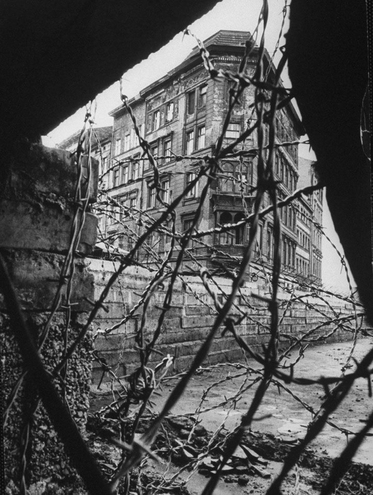 Berlin is seen through barbed wire and rubble