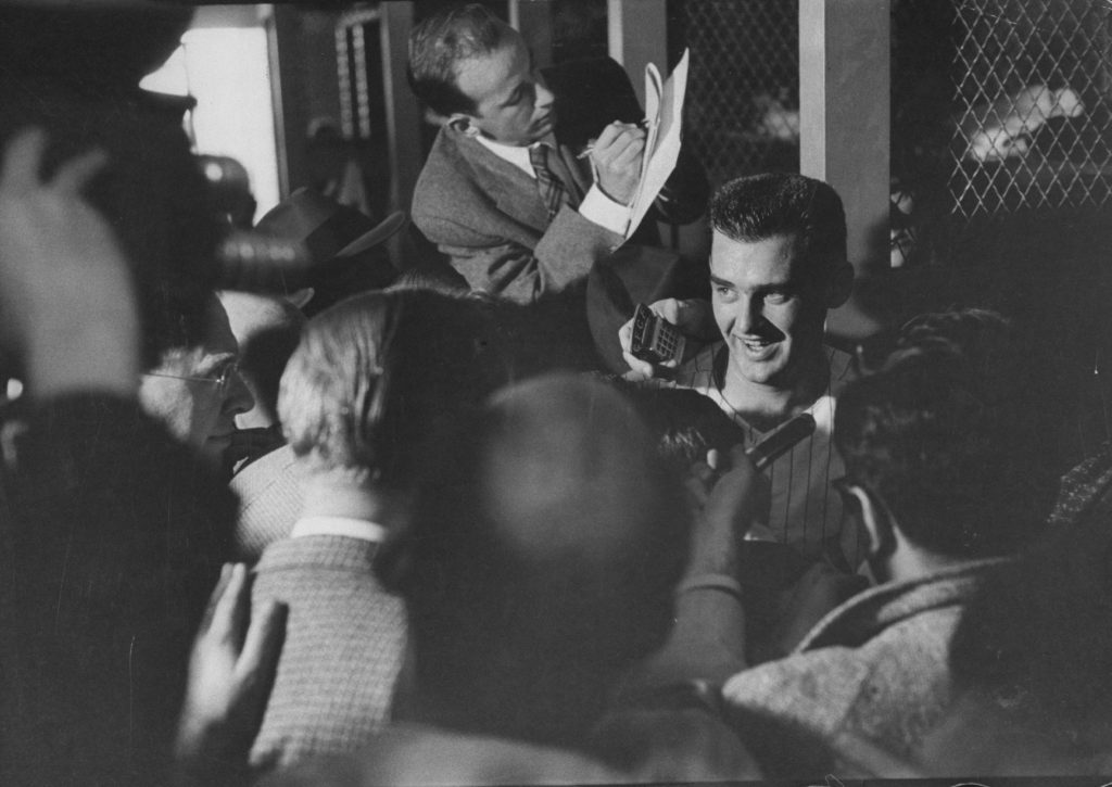 Don Larsen, of the New York Yankees, talks to the press after Game 5 of the 1956 World Series, against the Brooklyn Dodgers, Oct. 8, 1956. Larsen, who had an otherwise nondescript career, pitched the only perfect game in World Series history.