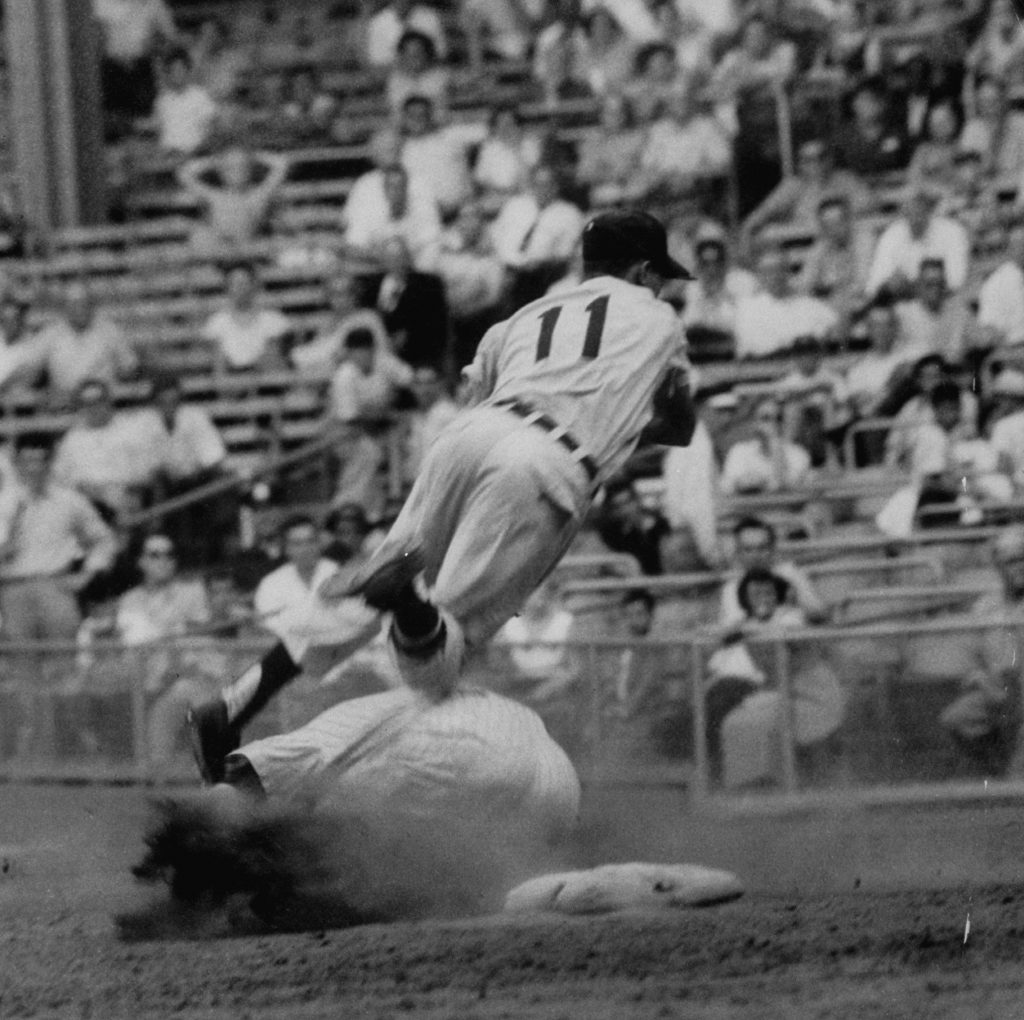 Mickey Mantle slams into Luis Aparicio's feet while sliding into second, June 1956.