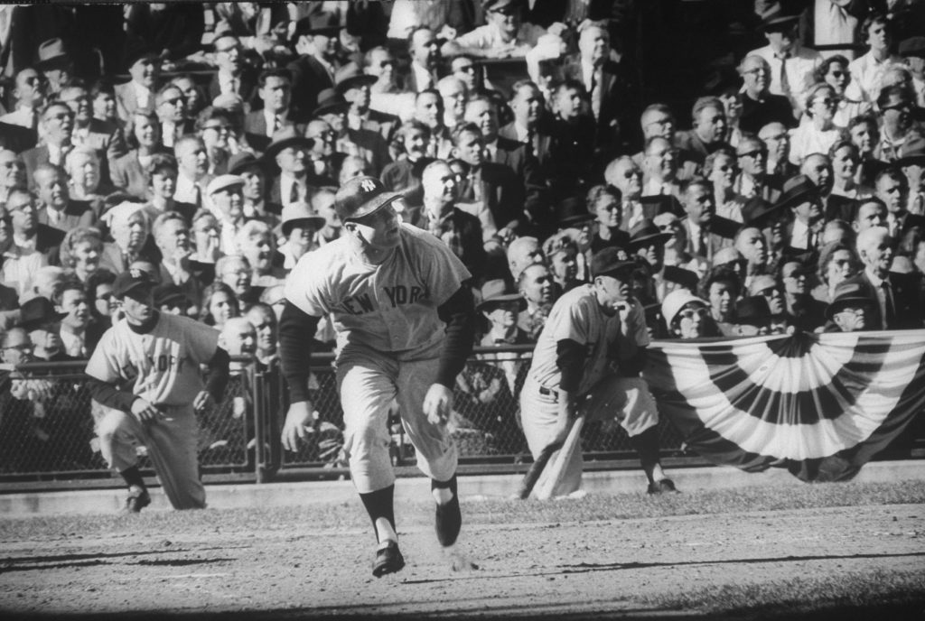 Mickey Mantle, center, hits a home run in World Series game in Pittsburgh in October 1960.