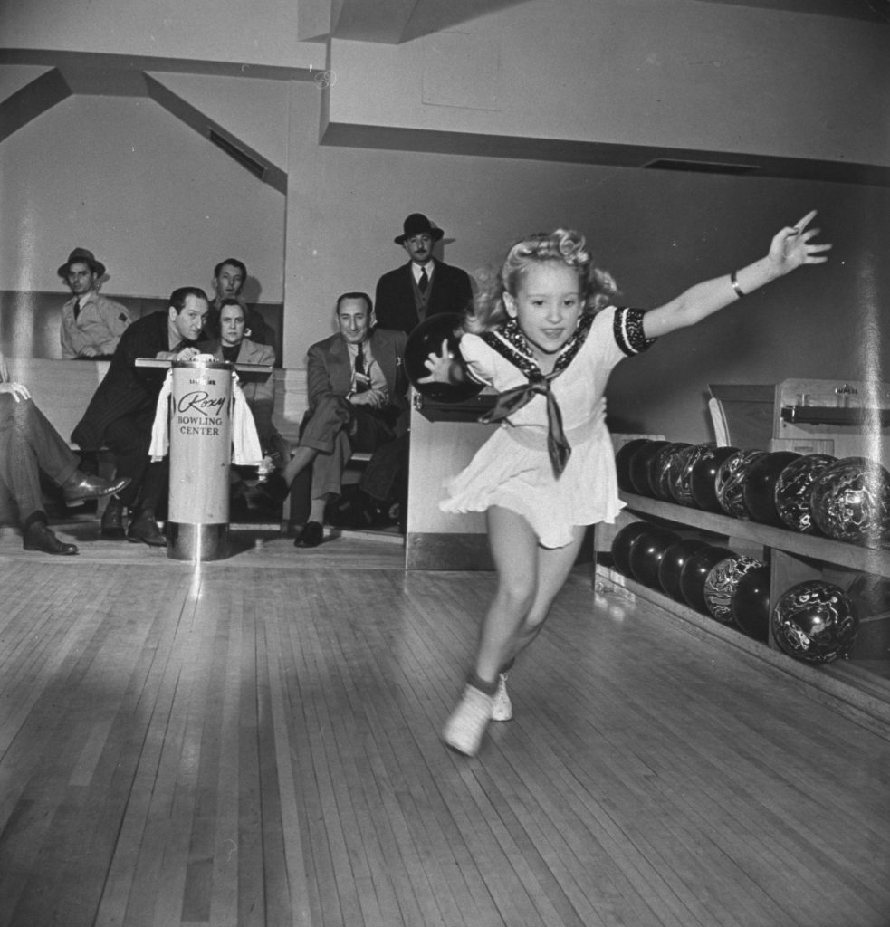 Twinkle Watts, a child bowler and ice skater, is pictured mid-stride