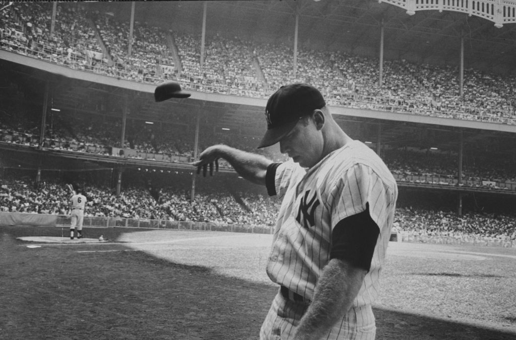 After a weak at-bat, Mickey Mantle flings his helmet away in disgust, June 25, 1965.