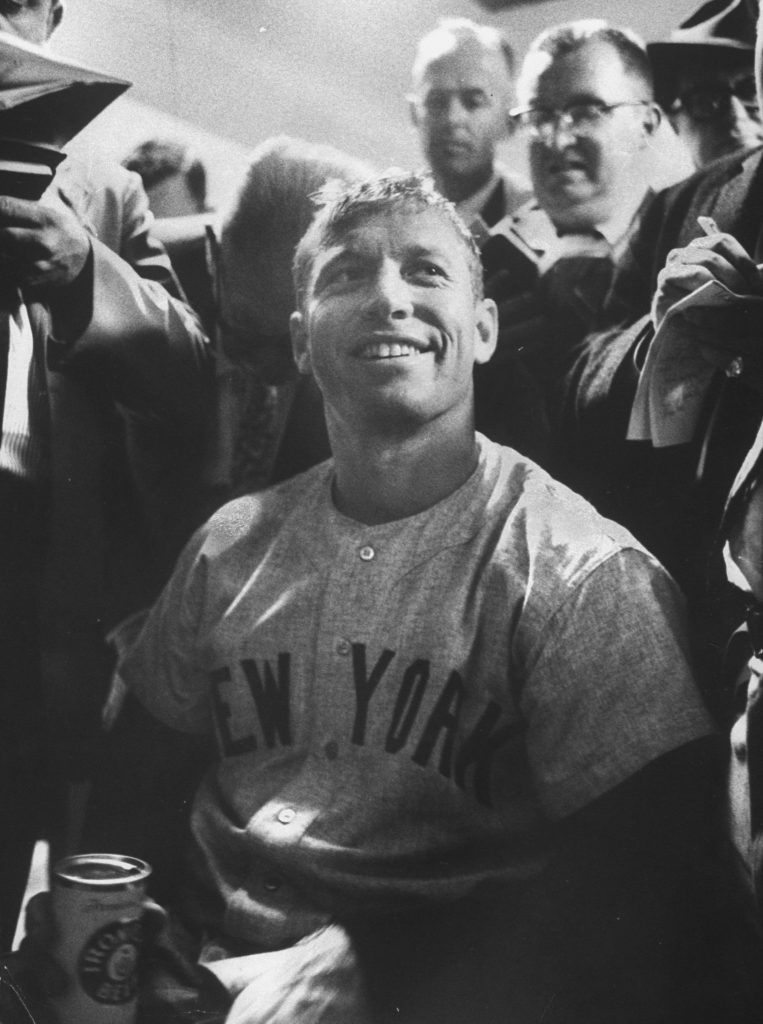 Surrounded by the press, Mickey Mantle, center, smiles after hitting two home runs in the World Series against the Pittsburgh Pirates in October 1960.