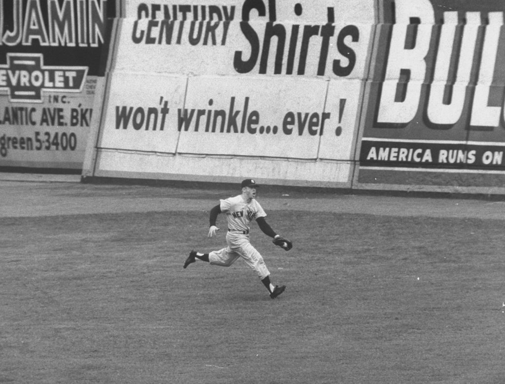 Mickey Mantle makes a running catch on a fly ball to left field during the 3rd game of the World Series at Ebbets Field in Brooklyn, NY on September 30, 1955.