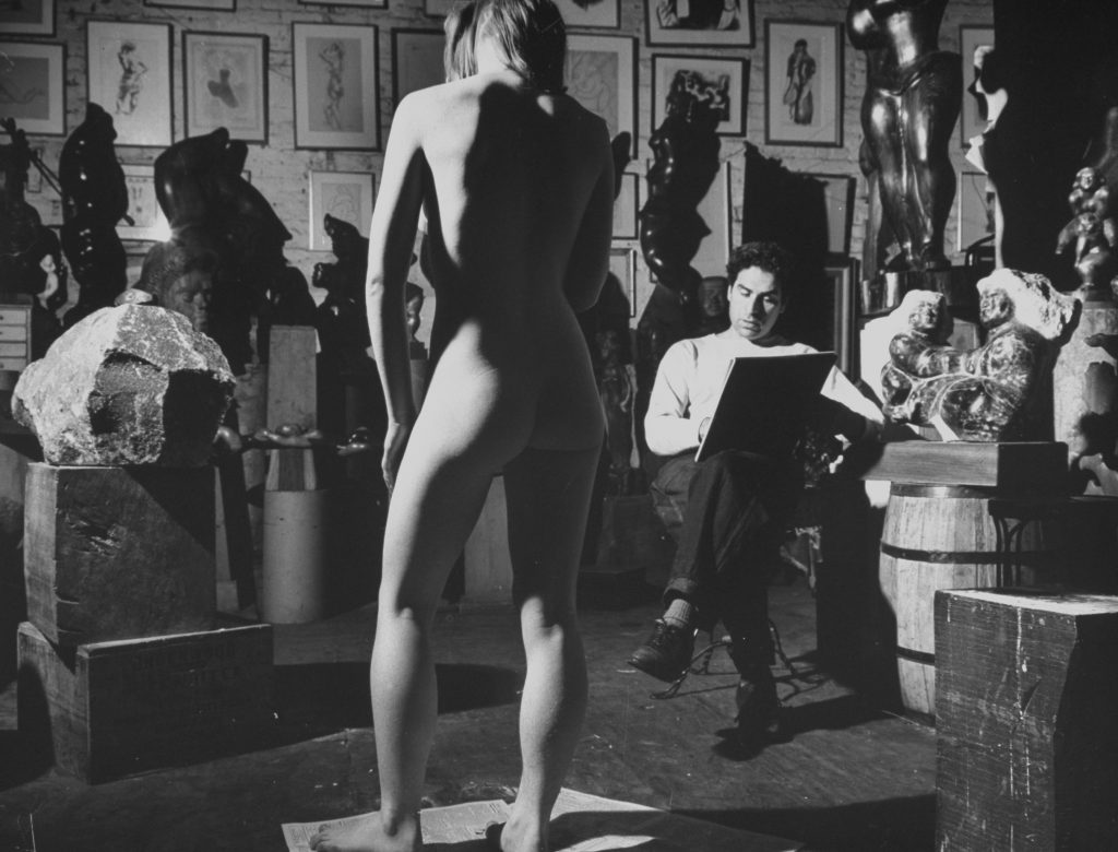 Sculptor Chaim Gross sketches a nude model in 1942.