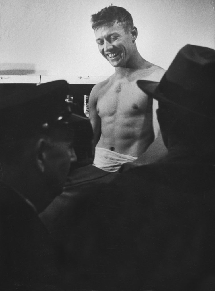 Mickey Mantle grins in the locker room after a World Series game, October 1952.