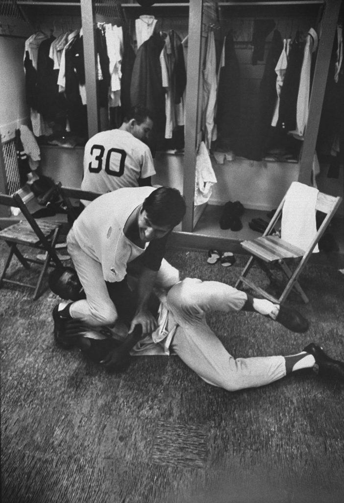 Carl Yastrzemski, left, and Joe Foy horse around in the Red Sox locker room, May 1, 1968.