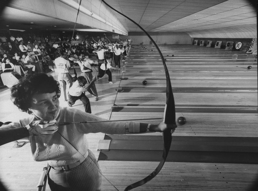 Archers shoot arrows alongside bowlers at the Sunnyside Bowl