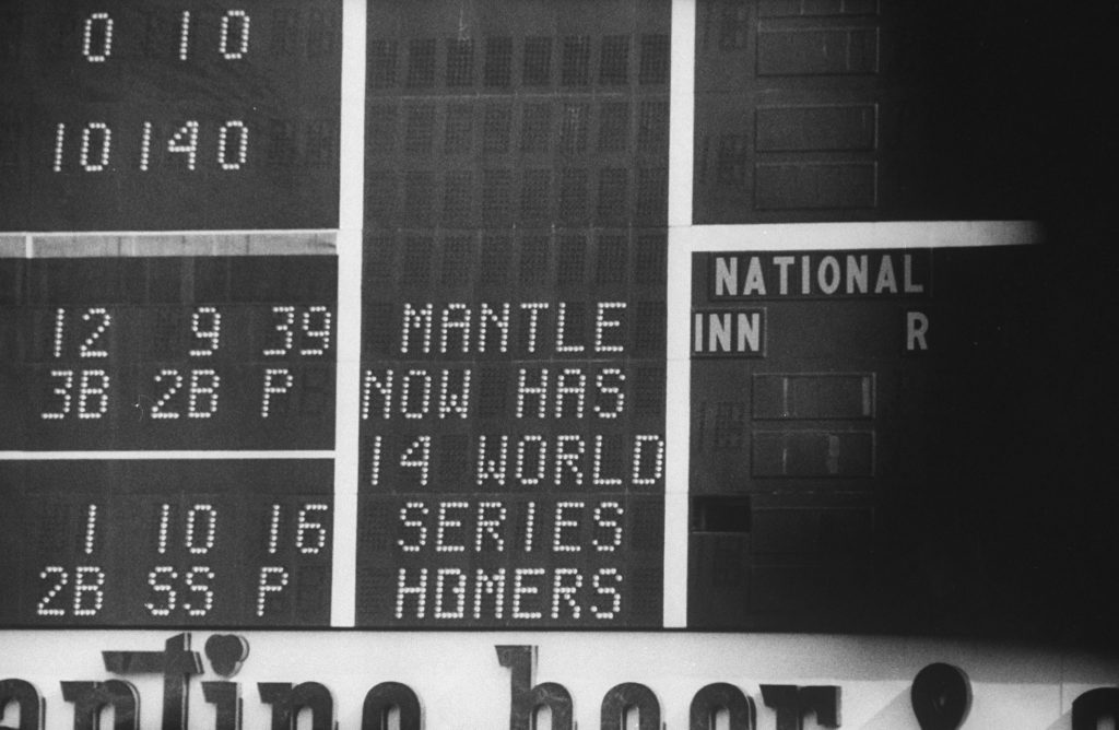 "Score board reading ""Mantle Now Has 14 World Series Homers,"" October 1960."