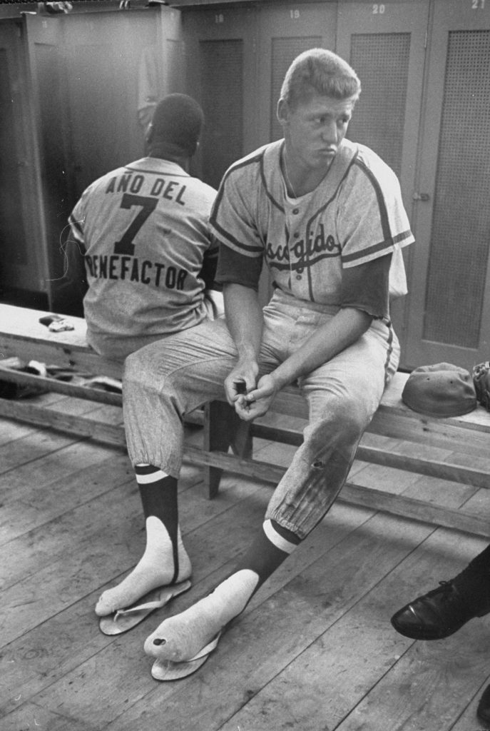 Baseball player Frank Howard, center, sits in the locker room during the winter league season, December, 1959.