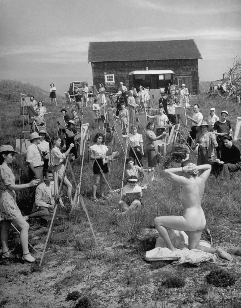 A large group of Farnsworth Art School students paint a nude model in 1946.