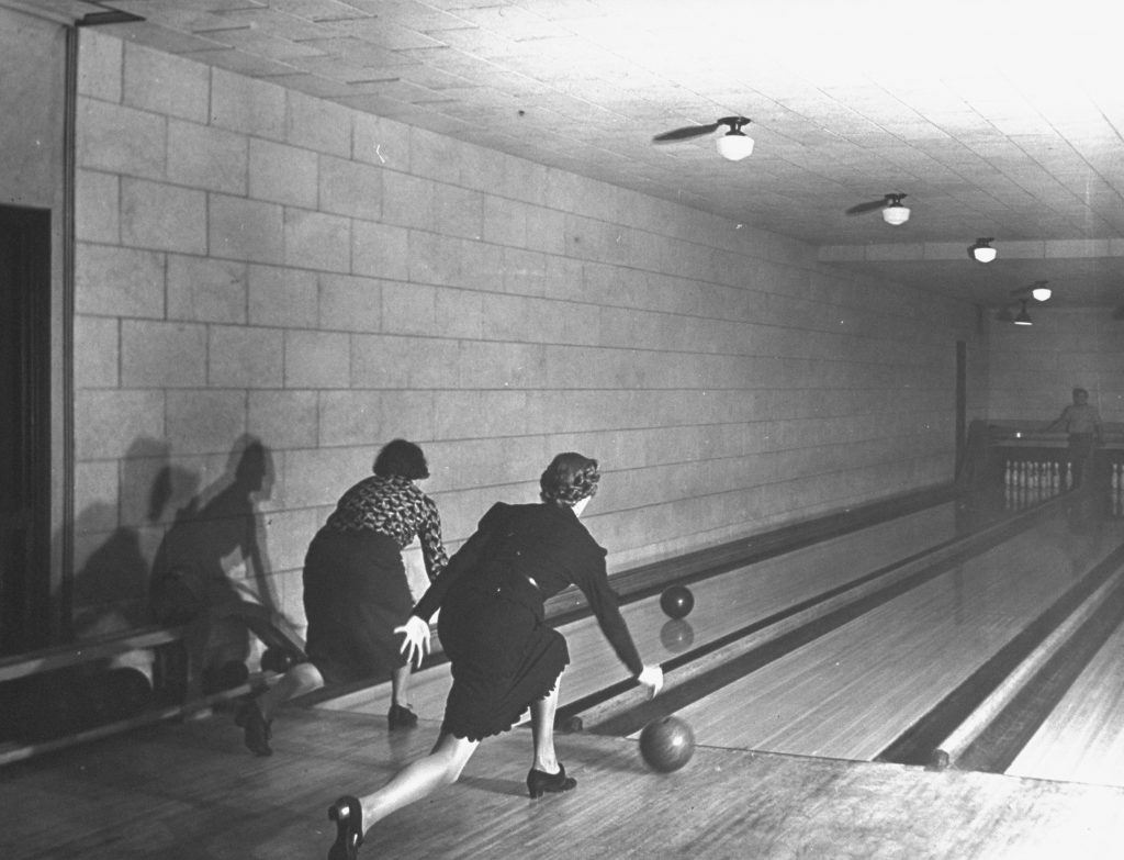 Women bowl in two of the four bowling alleys located under the chapel of New York's Riverside Church.