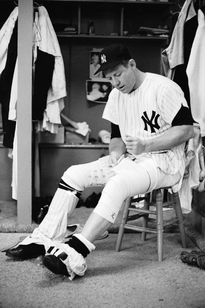 Mickey Mantle bandages his leg in the locker room before a game, June 1965.