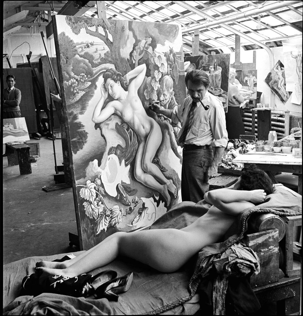 """The American painter Thomas Hart Benton (1889 - 1975) works on his painting """"Persephone"""""""