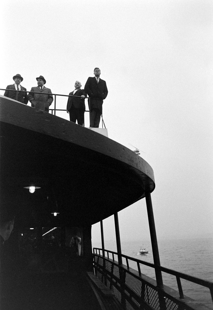 John F. Kennedy gazes out on New York Harbor from a ferry, October 1960.