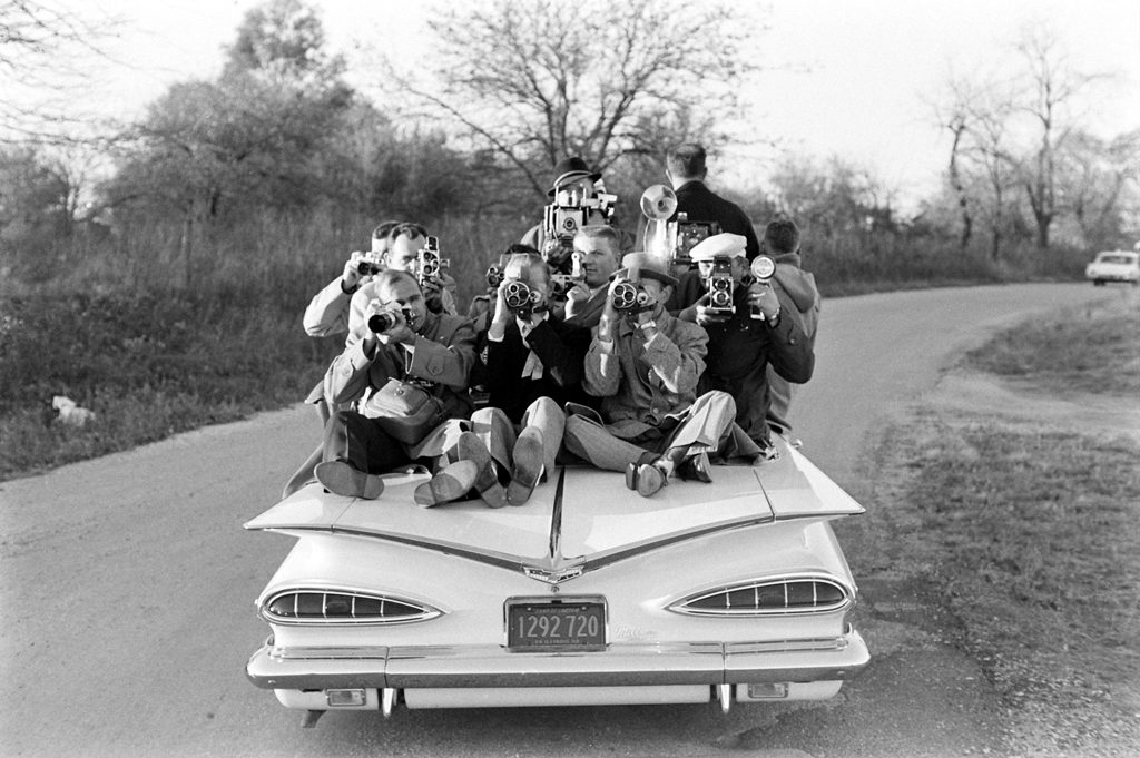 On a drive through Illinois, Paul Schutzer turns his camera on his colleagues in the press, 1960.