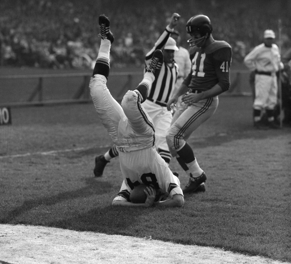 Steelers receiver Buddy Dial (upended) lands on the 1-yard line as the Giants' Lindon Crow arrives a moment too late to make the play.