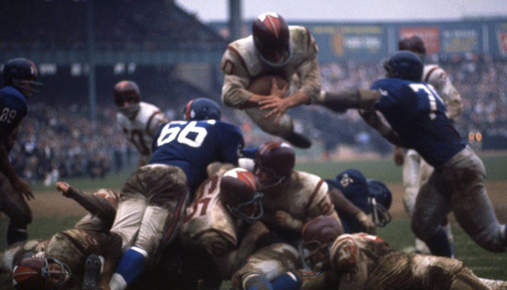 Redskins fullback John Olszewski (wearing a #0 jersey) leaps for a touchdown against the Giants.
