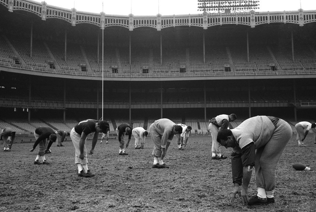 Future Hall of Famer Andy Robustelli leads the Giants in a workout session at Yankee Stadium.