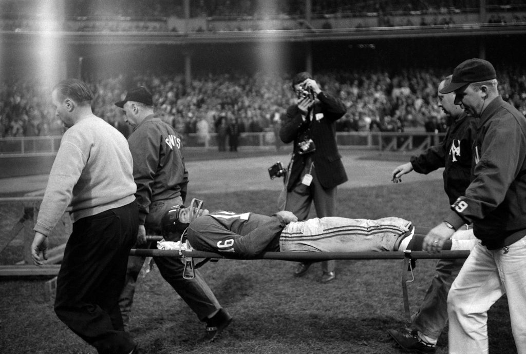 Frank Gifford is carried off the field on a stretcher after a near-career-ending hit by the Eagles' Chuck Bednarik.