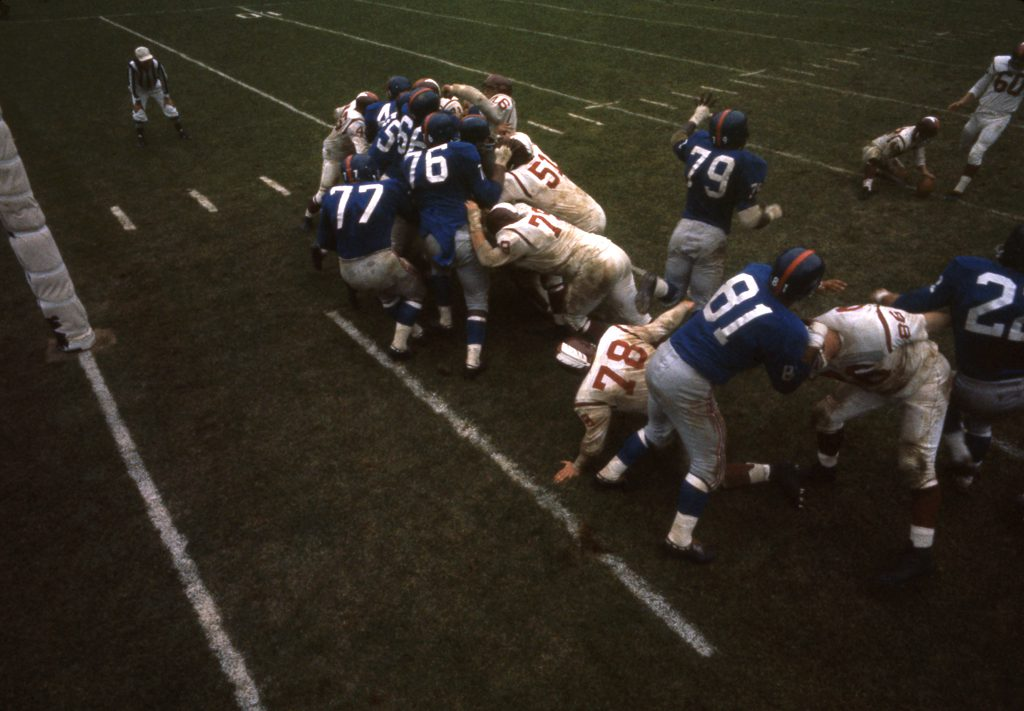 """In a game against the Redskins, Grier, Robustelli (#81), and other Giants fight to block an extra point attempt by the 'Skins 6' 2"""", 230-lb. kicker and guard, Bob Khayat."""