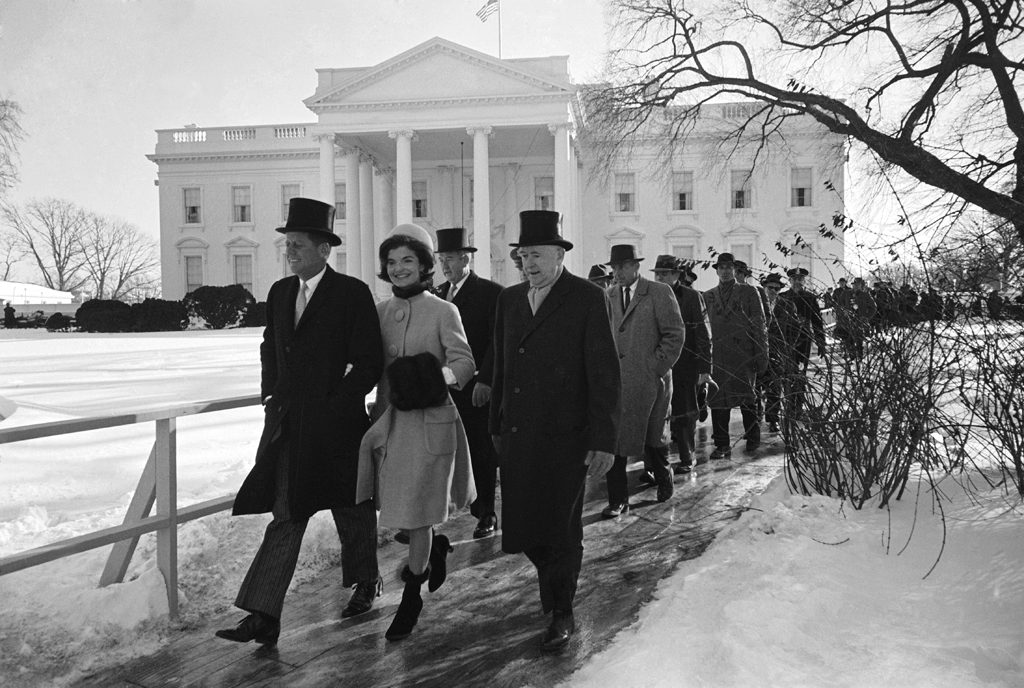 John and Jackie Kennedy walk to JFK's inauguration ceremony from the White House, January 1961.
