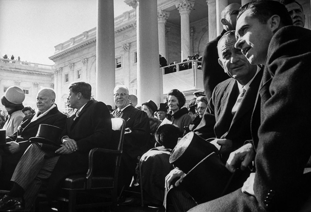 John F. Kennedy, Jacking Kennedy, Dwight Eisenhower, Lydon Johnson, and Richard Nixon wait for the inaugoration to begin.