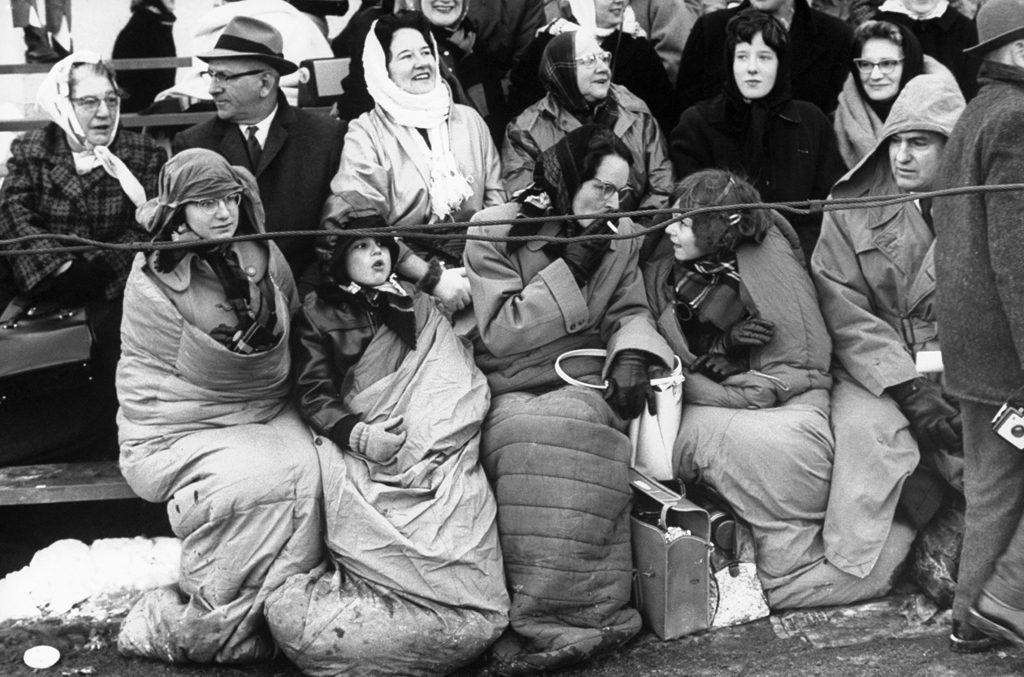 Bundled onlookers gather on Pennsylyvania Avenue on the day of John Kennedy's inauguration.