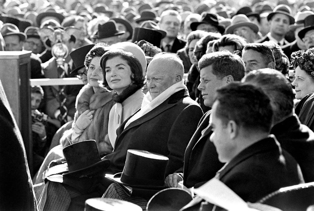 Lady Bird Johnson, Jackie Kennedy, Dwight Eisenhower, John Kennedy, Lyndon Johnson and Richard Nixon seated during the inauguration.